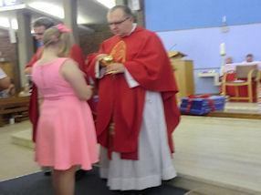 Receiving the Holy Eucharist from Bishop Robert.