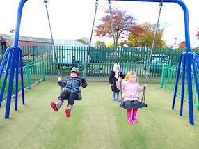 We played on the swings.