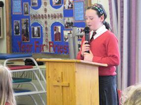 A Year 6 pupils reads the introduction to our Mass