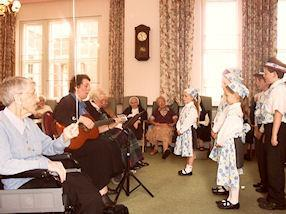 The Von Trapp Singers entertain the sisters.