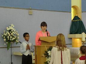 Leading the introduction to the Mass.