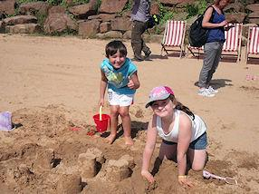 Look at our sandcastles!