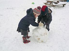 Building a snowman takes lots of concentration.