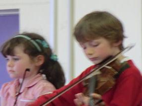The viola and violinists enjoy playing