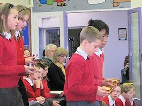 Children present the Offertory gifts.