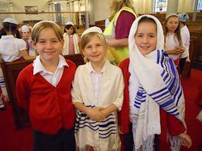 Wearing Jewish headwear.