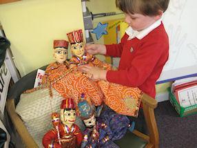 We heard all about Rama and Sita and used puppets