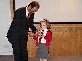Dr Suresh presents a prize to the joint winner
