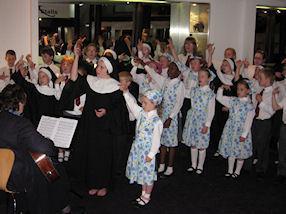 The choir perform joyfully