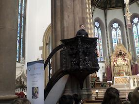 Preaching from the pulpit.