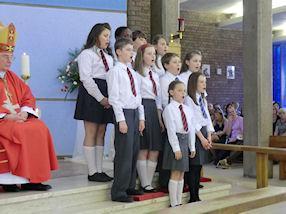 Children sing the Responsorial Psalm.