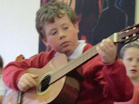 Guitarists sharing their musical expertise.