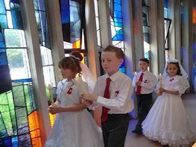 Carrying their Communion candles