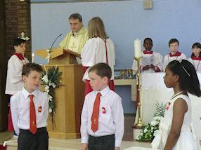 Children prepare for the Gospel Reading.