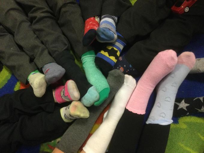 Children showing off their odd socks