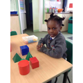 We have been learning the names of 3D shapes