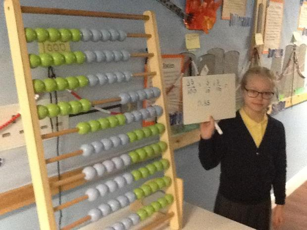 an abacus to understand tenths and hundredths