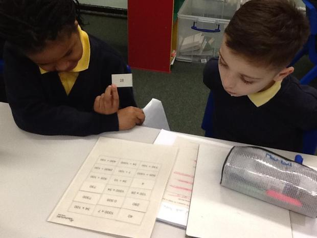 multiplying and dividing by 10, 100