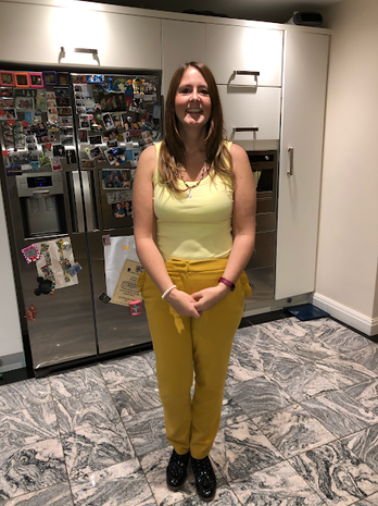 Miss Robinson wearing yellow while working from home.