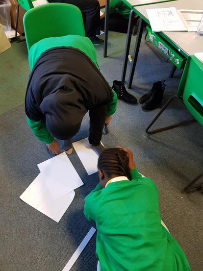 We worked in pairs to measure our feet.