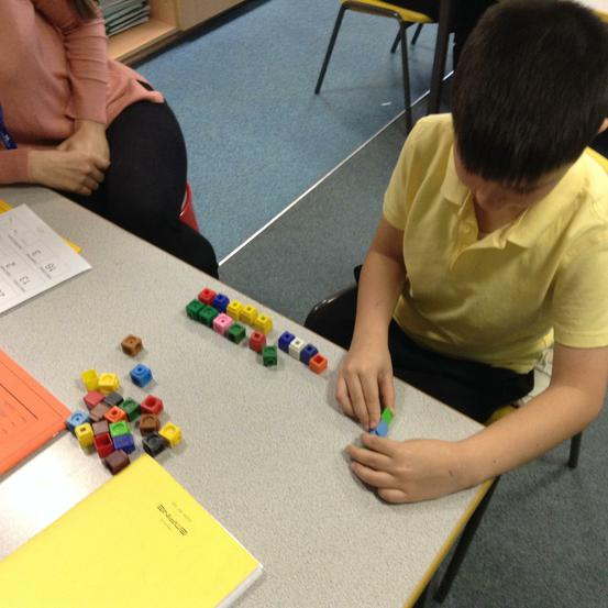 Using cubes to help with grouping.