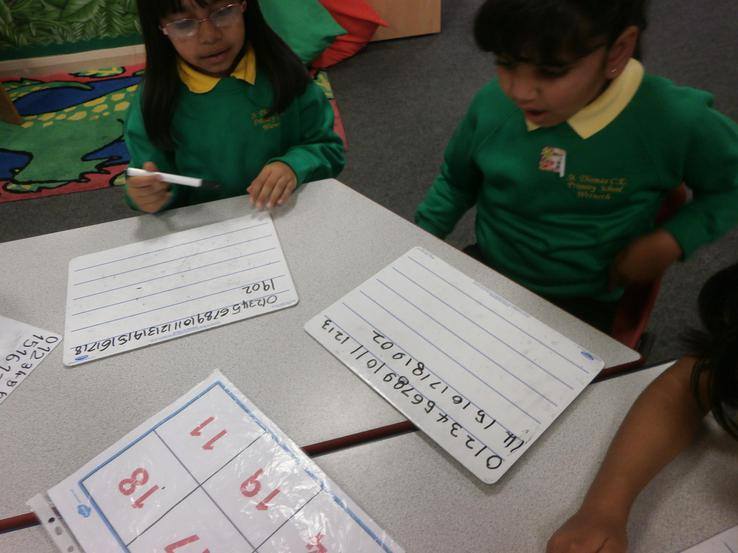 Practising their formation of numbers