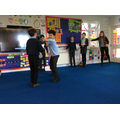 Acting out Macbeth in drama.