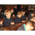 Times tables with a slate and chalk