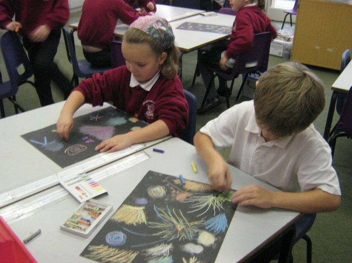 Toby and Elise using chalks and pastels to draw