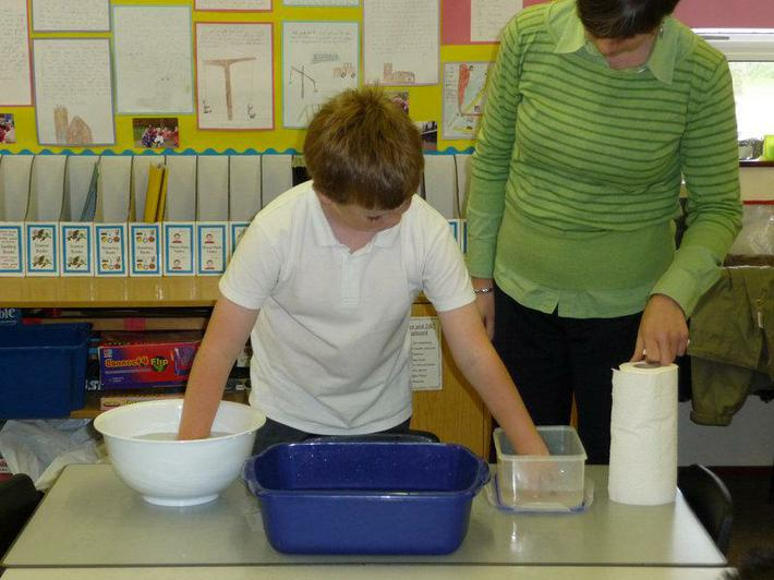 Experimenting putting our hands in water