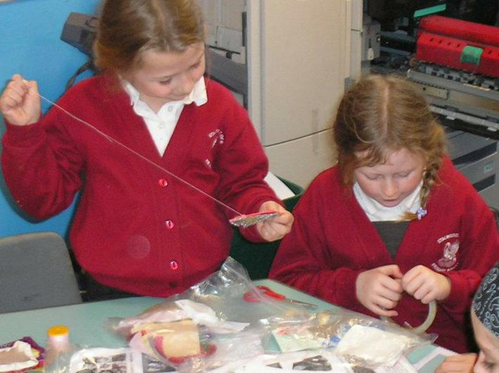 Helping each other to sew together.