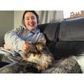 That cat is definitely enjoying your company!