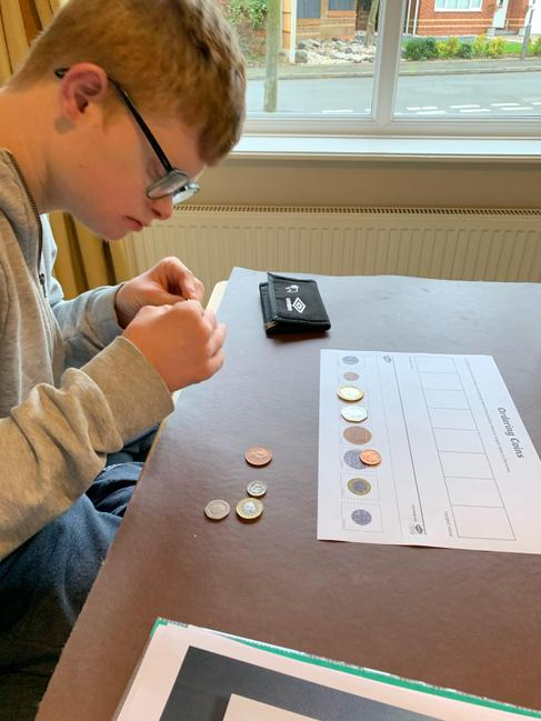 Macauley has been matching up coins.