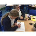 Working on our Math's skills whilst in competition with our partner.