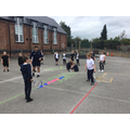 Practicing control in tennis during PE.