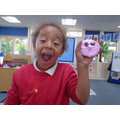 Decorating pink 'piggy biscuits'