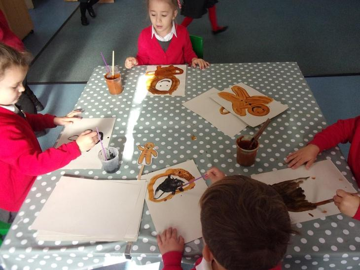 We painted our own Gingerbread men using ginger scented paint!