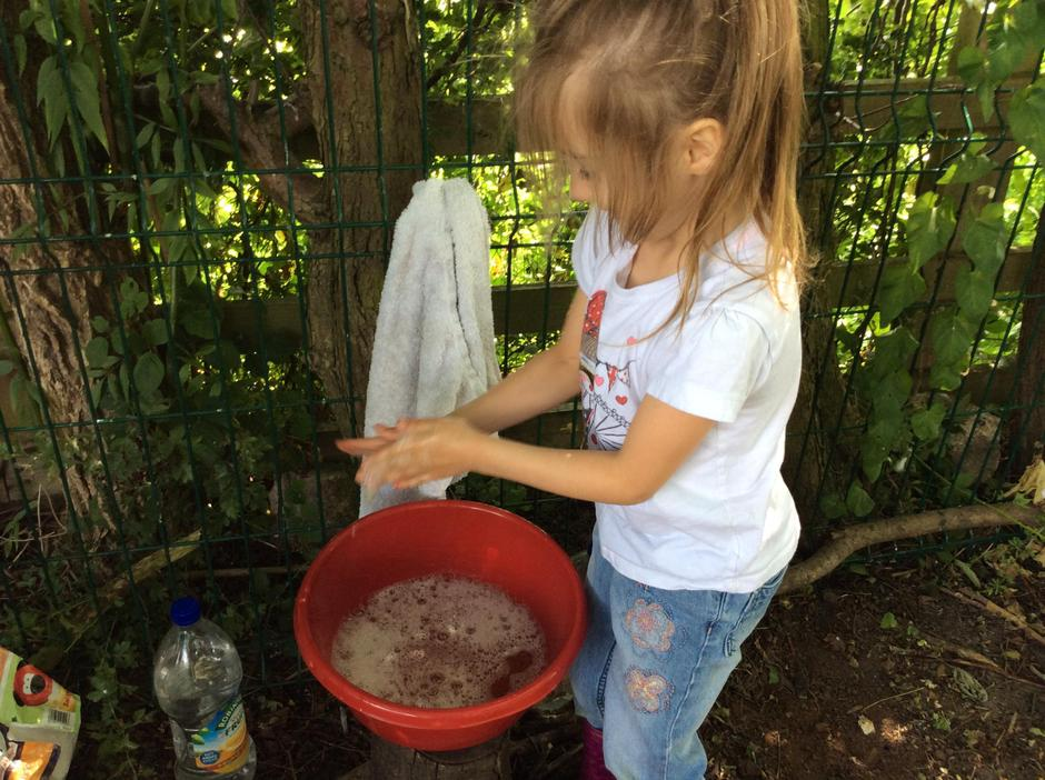 Washing our hands before eating our treat.