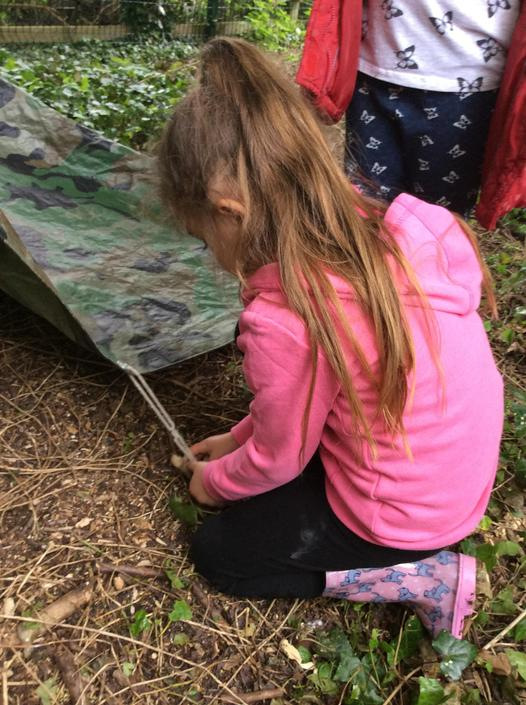 Making our own pegs to hold down the tarp.