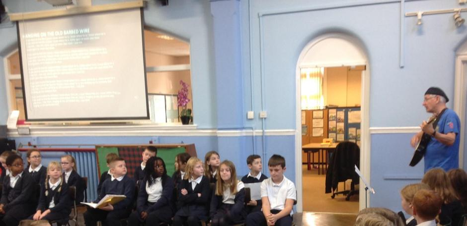 Mr Webb leading Class 5 in an assembly