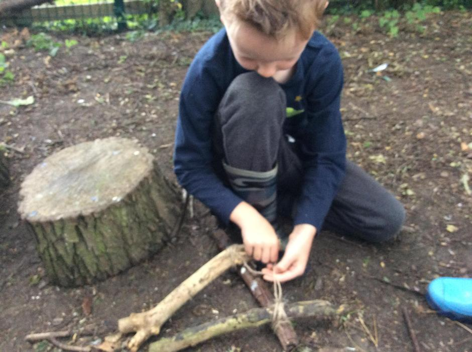 Tying knots and making a triangular frame.