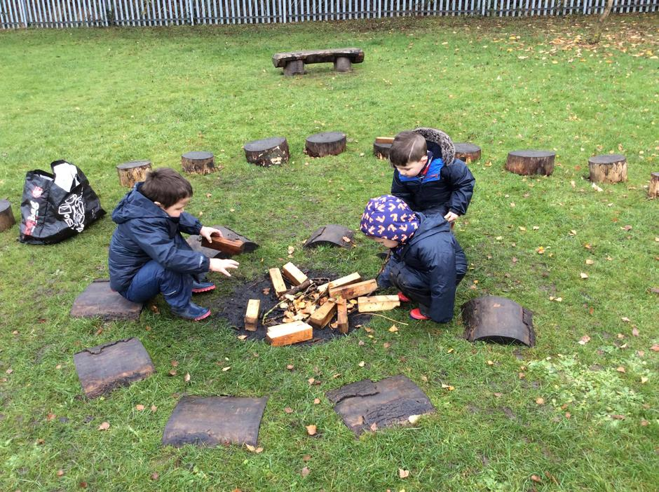 Working hard on the 'camp fire'