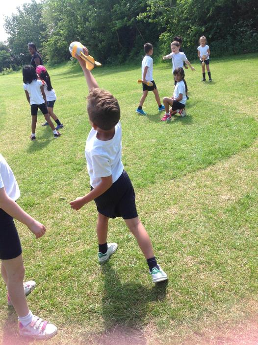 Performing a throw with co-ordination and control.
