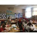 Class 5 enjoying oil pastel work inside