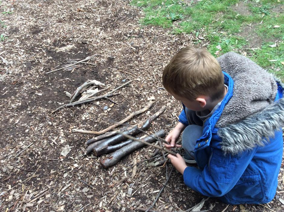 Sorting sticks into the correct sizes for the fire