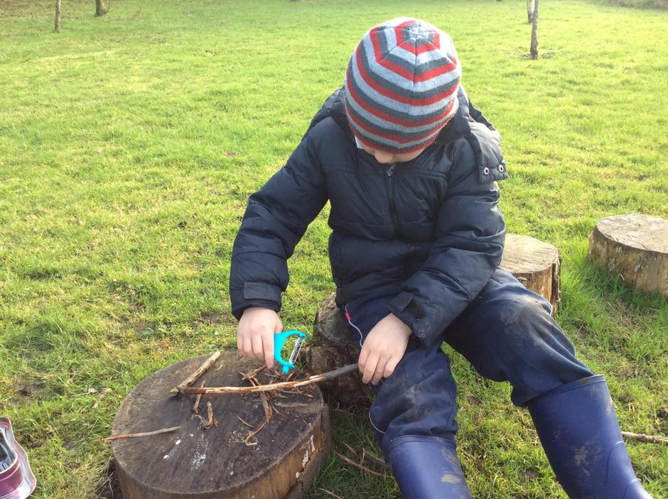 Learning how to use tools safely and whittle wood.