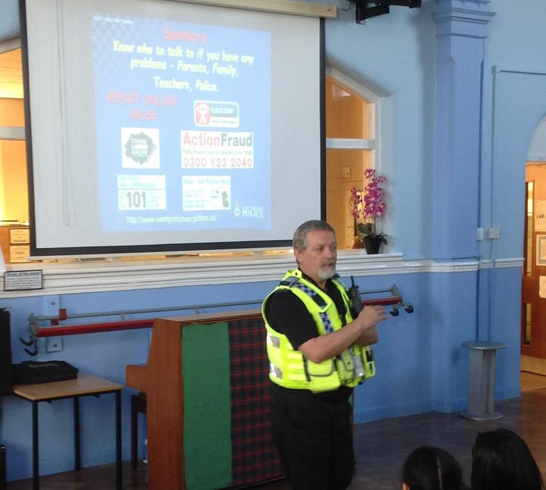 An assembly about e-safety led by a police officer