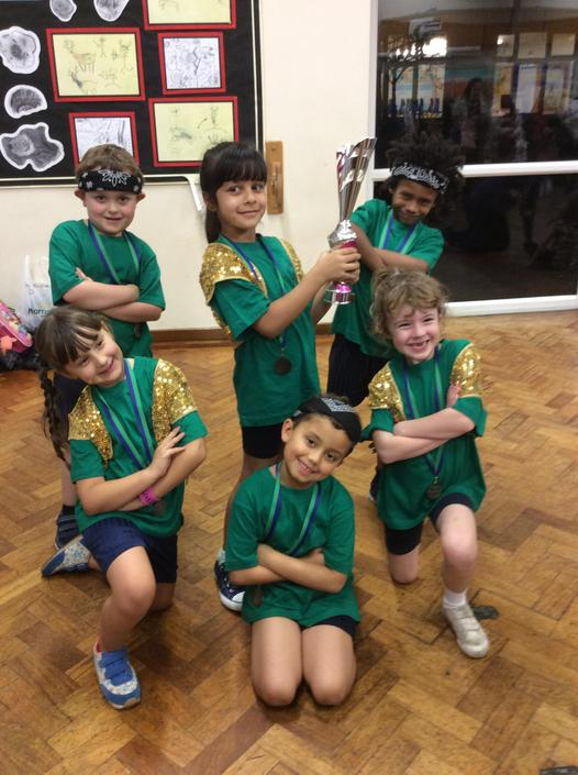 Year 2 celebrating with their Runners up trophy.