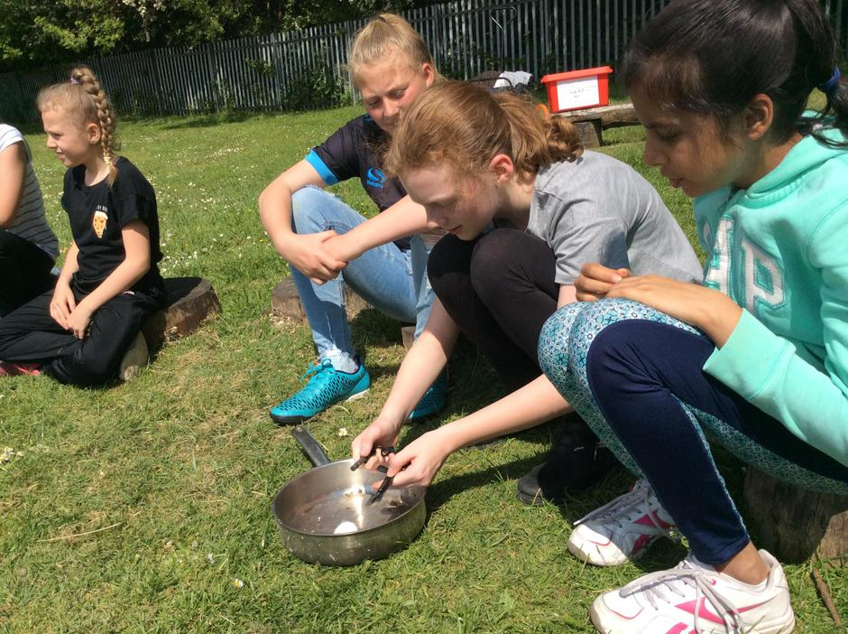 Using friction to create fire.
