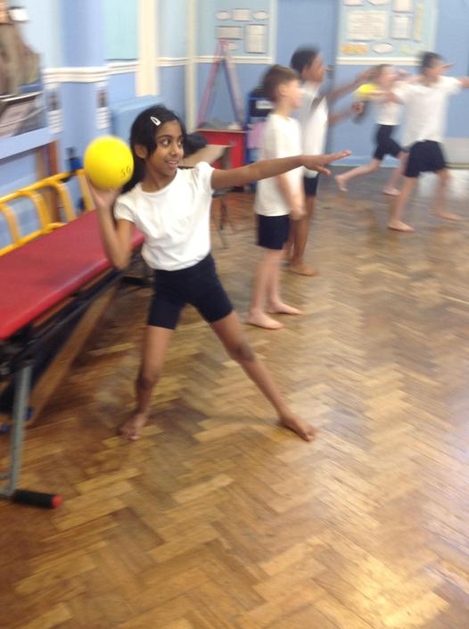 Adjusting body shape to send the ball accurately.